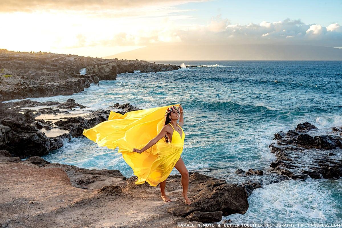yellow dress on volcanic coastline